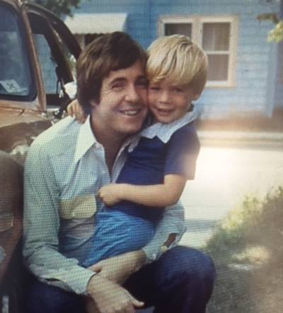 John Allan Cameron shares a tender moment with his son Stuart when he was away from the road.